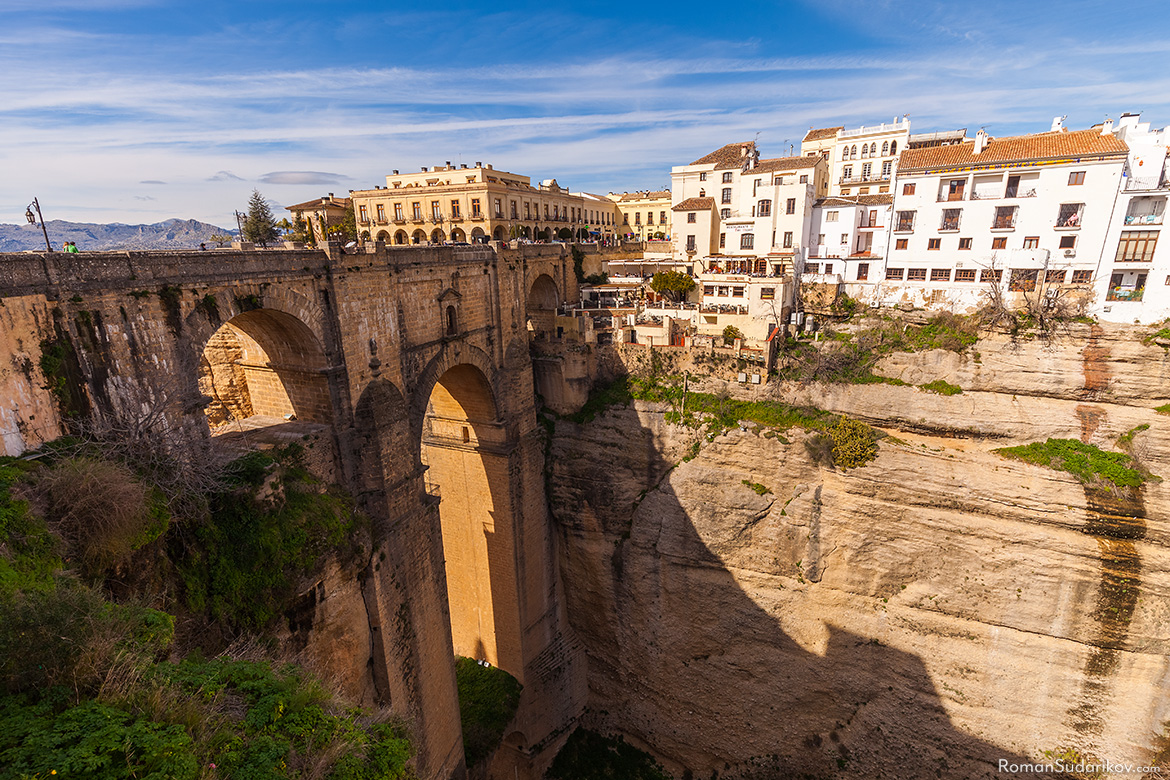 "Three arch bridge Puente Nuevo, which means in English ""New Bridge"", over the El Tajo gorge, is connecting the old and the new parts of the town Ronda. This view is from the east side of the bridge. Andalusia, Andalucia, Spain."