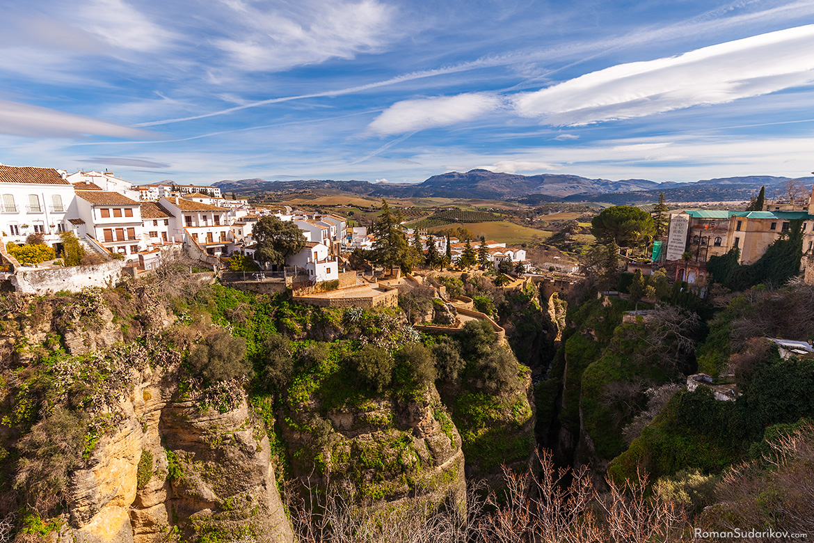 "A view of El Tajo gorge in the direction away from the bridge Puente Nuevo. A bit further is another smaller bridge named Puente Viejo, which translates as ""Old Bridge"". Andalusia, Andalucia, Spain."