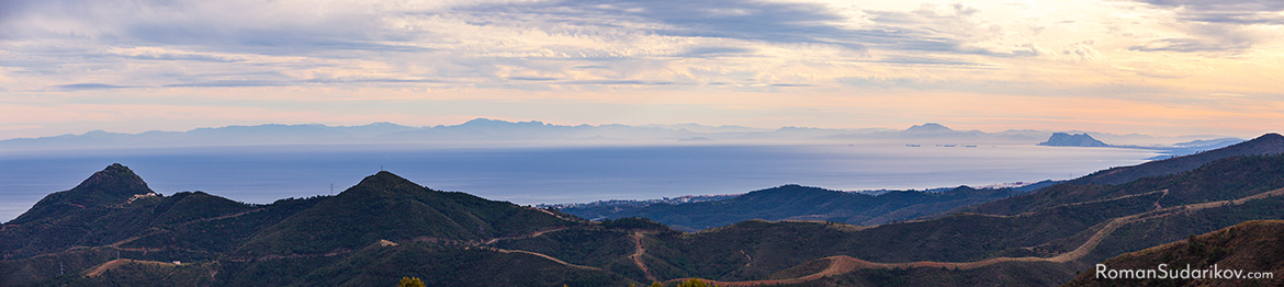 In this picture taken right before sunset you can see both coasts of Mediterranean Sea. On the right is the rock of Gibraltar and at the horizon is the coast of Africa. Costa del Sol, Spain.