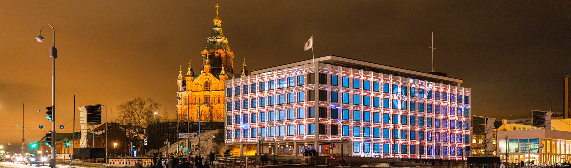 Light nstallation Cube by a three-person production team Shader, which consists of Pekka Tavi, Mikko Kunnari and Timo Yliräisänen. The animation is projected on the head office of Stora Enso from the side of the Market Square. Lux Helsinki 2017 Light Festival.