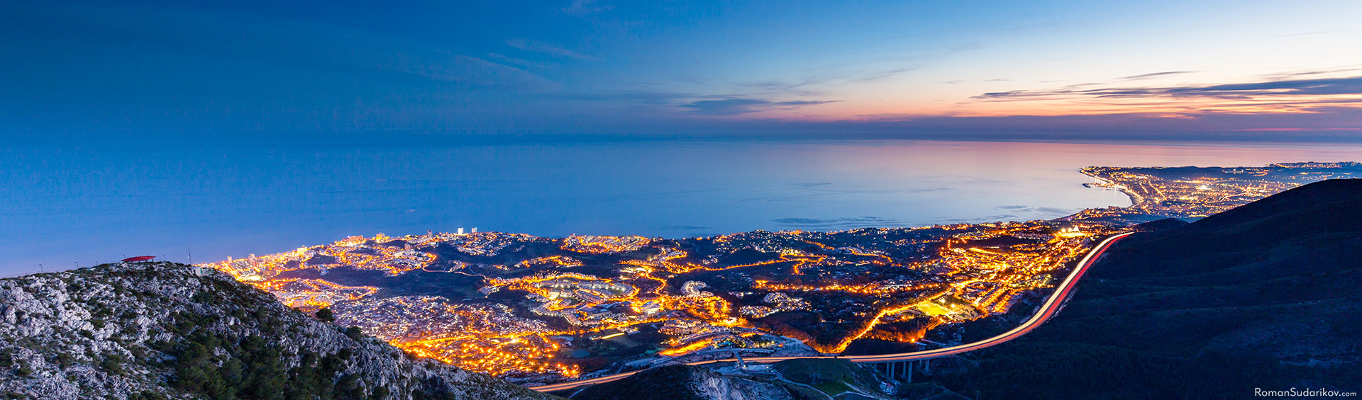 The lights of Benalmádena during the night. The picture is taken from the top of the mountain Calamorro. Costa del Sol, Spain.
