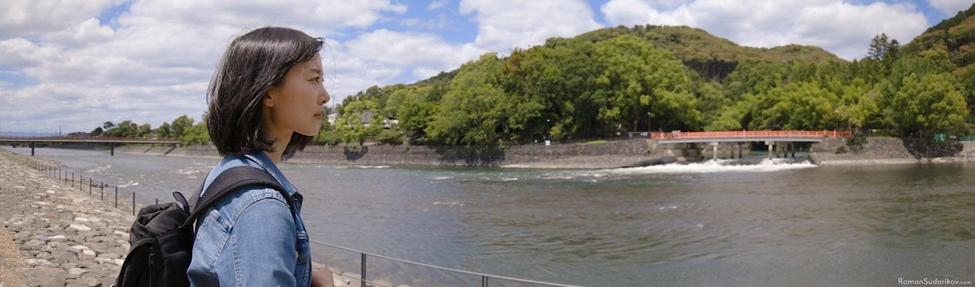 Kan is walking along Uji river